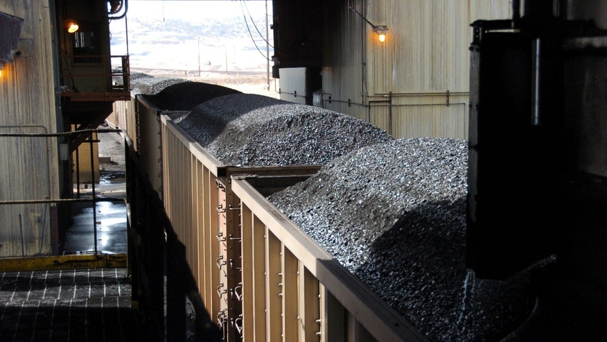 April 4, 2013: Coal bound for South Korea via a West Coast port passes through a loading terminal at Cloud Peak Energy's Spring Creek mine near Decker, Mont.