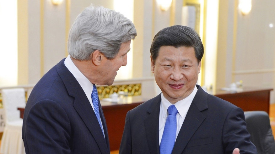 Chinese President Xi Jinping, right, poses with U.S. Secretary of State John Kerry before their meeting at the Great Hall of the People in Beijing Saturday, April 13, 2013. The question of how Washington can persuade Beijing to exert real pressure on North Korean leader Kim Jong Un's unpredictable regime is front and center as Kerry meets Saturday with Chinese leaders in Beijing. (AP Photo/Yohsuke Mizuno, Pool)