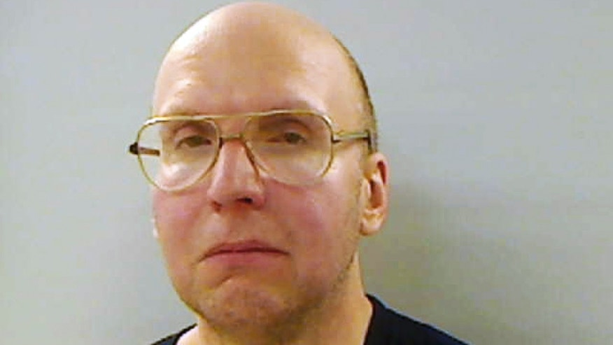 FILE - This April 2013 file booking photo provided by the Kennebec County Sheriff's Office in Augusta, Maine, shows Christopher Knight, arrested Thursday, April 4, 2013, while stealing food from a camp in Rome, Maine. Knight's former classmates remember him as quiet, smart and nerdy. (AP Photo/Kennebec County Sheriff's Office, File)