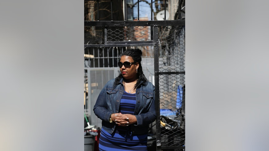 "In this Monday, April 8, 2013 photo, Deirdre Myers poses for a picture near her home in New York. Police took Myers and her teen daughter into custody in 2010 in what's known as a ""bait car"" operation. It involved leaving a wad of cash in an unattended car and seeing if a would-be thief would take advantage. The dismissal of the case against the single mother has drawn attention to police tactics that a judge ruled went too far. (AP Photo/Seth Wenig)"