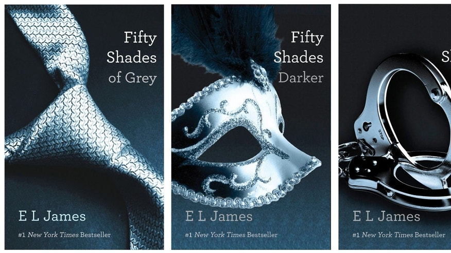 "FILE- This file combo made of book cover images provided by Vintage Books shows the ""Fifty Shades of Grey"" trilogy by best-selling author E L James. On Monday, E L James' erotic trilogy placed No. 4 on the American Library Association's annual study of ""challenged books,"" works subject to complaints from parents, educators and other members of the public. (AP Photo/Vintage Books, File)"