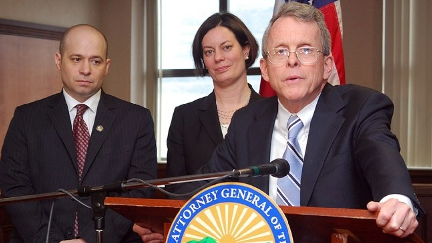 March 17, 2013: Ohio Attorney General Mike DeWine, right, answers questions about the successful prosecution of two juveniles in a rape case during a news conference at the Jefferson County Justice Center in Steubenville, Ohio. Prosecutor Brian Deckert and Prosecutor Marianne Hemmeter joined DeWine.