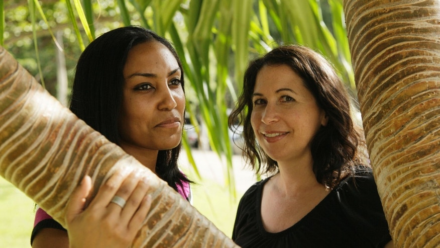 In this Dec. 19, 2011 file photo, Taeko Bufford, left, and Diane Cervelli, right, pose near Waikiki beach in Honolulu.