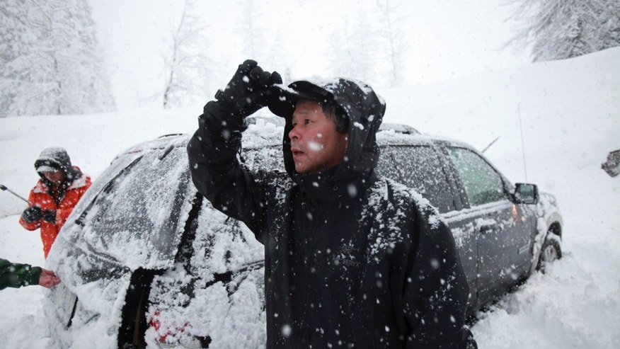 This photo taken Saturday, April 13, 2013 shows Won Shin, 56, of Mukilteo, Wash. who was among the four who made it off the mountain first. Shin, was among the group of 12 snowshoers who were on Red Mountain at the time of the avalanche. (AP Photo/The Seattle Times, Ken Lambert)