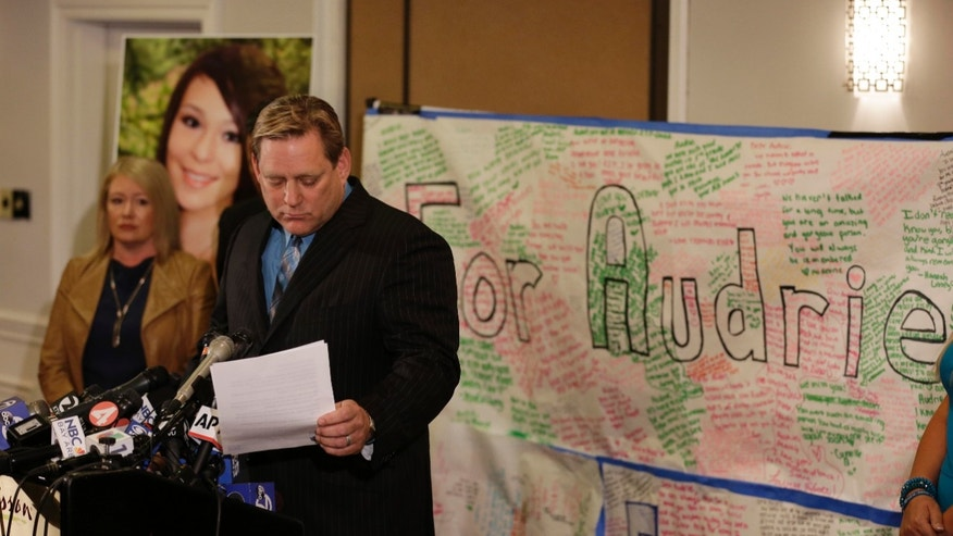 Larry Pott, father of Audrie Pott who committed suicide after she was sexually assaulted, reads a statement as Sheila Pott, left, Audrie's mother, looks on during a news conference Monday, April 15, 2013 in San Jose, Calif. The family of a girl who committed suicide after she was sexually assaulted and a photo of the act was shared in text messages said Monday the three 16-year-old boys responsible were sober when the assault happened. They said they were outraged by what they see as a refusal to take responsibility by the three boys arrested in the attack on the 15-year-old girl in Saratoga, a bedroom community on the fringe of Silicon Valley. (AP Photo/Eric Risberg)