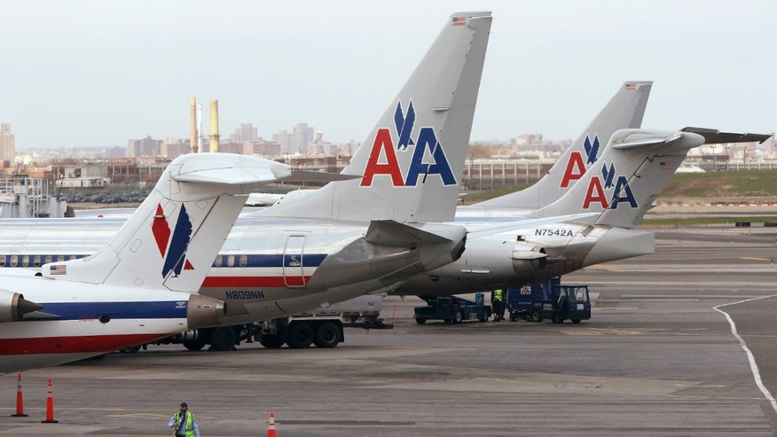 April 16, 2013: American Airlines aircraft sit on the tarmac at LaGuardia airport following a reservation system outage in New York.