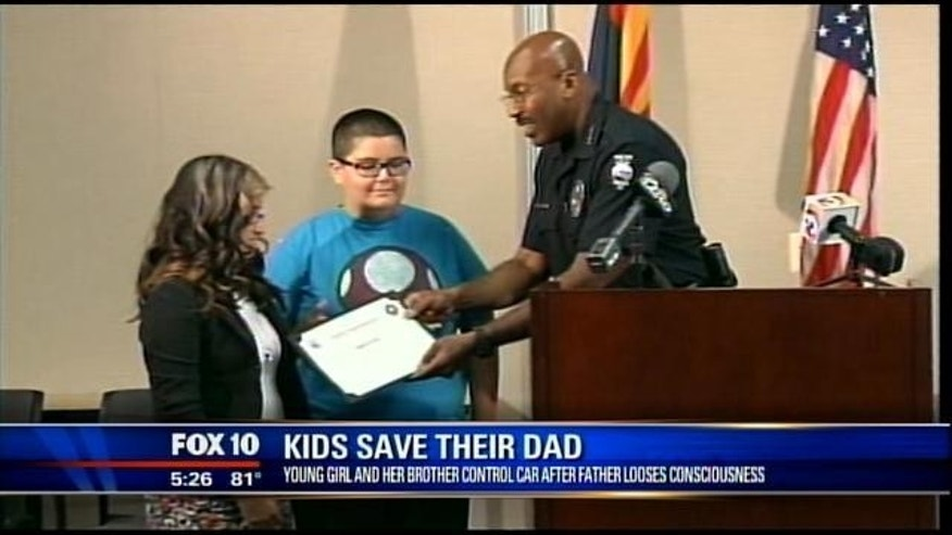 Apr. 15, 2013: Kylah Woody, 13, and her brother Michael, 11, are presented with the Peoria Police Department's bravery award in Peoria, Ariz.