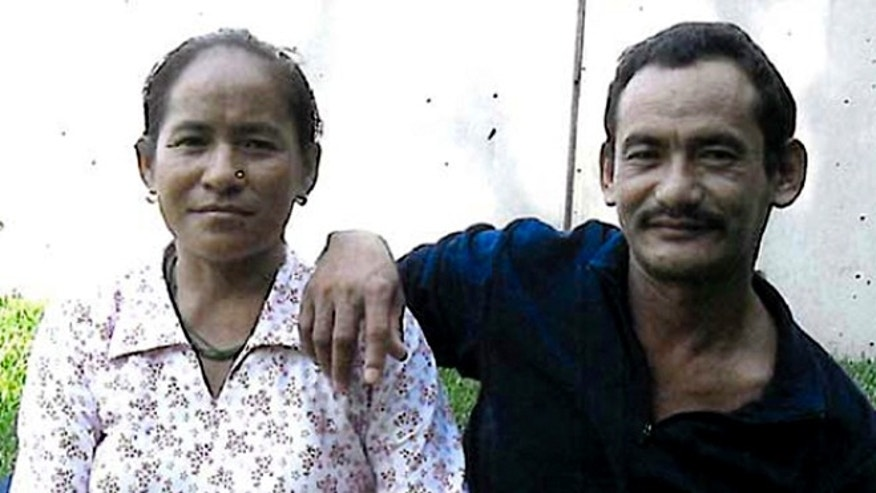 This undated photo released by the Philadelphia District Attorney's Office shows Karnamaya Mongar, left, and her unidentified husband. (AP/Philadelphia District Attorney)