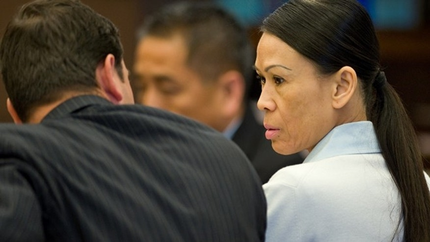 April 17: Catherine Kieu sits next to her attorney. Kieu is charged with cutting off a man's penis and throwing it into a garbage disposal.