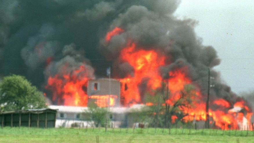 FILE - Fire engulfs the Branch Davidian compound near Waco, Texas, in this April 19, 1993 file photo. Some who survived the fiery end to the 51-day standoff at the Branch Davidians' Central Texas compound are to gather for a memorial service on the 20th anniversary of the fire Friday April 19, 2013. (AP Photo/Ron Heflin, File)