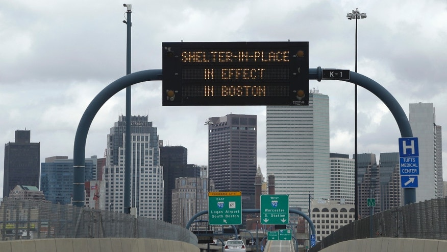 "A sign calling for citizens of Boston to ""Shelter in Place"" is shown on I-93 in Boston Friday, April 18, 2013. Two suspects in the Boston Marathon bombing killed an MIT police officer, injured a transit officer in a firefight and threw explosive devices at police during their getaway attempt in a long night of violence that left one of them dead and another still at large Friday, authorities said as the manhunt intensified for a young man described as a dangerous terrorist. (AP Photo/Elise Amendola)"