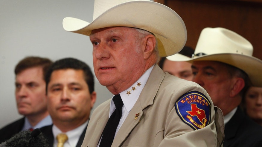 Sheriff David Byrnes speaks as local, state and federal law enforcement officers hold a news conference in Kaufman, Texas on Thursday, April 18, 2013.  Byrnes announced that Eric Lyle Williams, 46, and his wife, Kim Williams, are charged with capital murder in the the shooting deaths of Kaufman County District Attorney Mike McLelland and his wife, Cynthia, last month, and assistant prosecutor Mark Hasse in January. (AP Photo/The Fort Worth Star-Telegram, Rodger Mallison)  MAGS OUT; (FORT WORTH WEEKLY, 360 WEST); INTERNET OUT