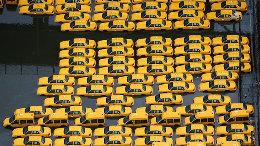 UNDATED: Flood damaged taxis in Weehawken, NJ, are among the thousands of cars that will need to be repaired or replaced in the coming weeks in the aftermath of superstorm Sandy.