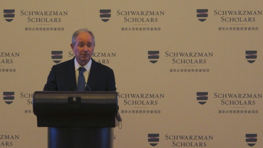 Stephen A. Schwarzman, founder of the U.S. private equity firm Blackstone, makes an announcement during a press conference at the Great Hall of People in Beijing, China Sunday, April 21, 2013. Schwarzman announced Sunday the establishment of a $300 million endowed scholarship program in China for students from around the world, and billed it as a rival to the prestigious Rhodes Scholarship. Schwarzman said he would give $100 million as a personal gift and raise another $200 million to endow the Schwarzman Scholars program at Beijing's Tsinghua University. It will be the largest philanthropic gift with foreign money in China's history, according to the tycoon and the university. (AP Photo/Didi Tang)
