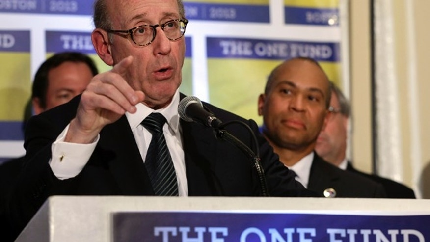 April 23, 2013: Kenneth Feinberg, an attorney who managed the 9/11 Victim Compensation Fund, speaks at a news conference in Boston, as Mass. Gov. Deval Patrick listens at right.