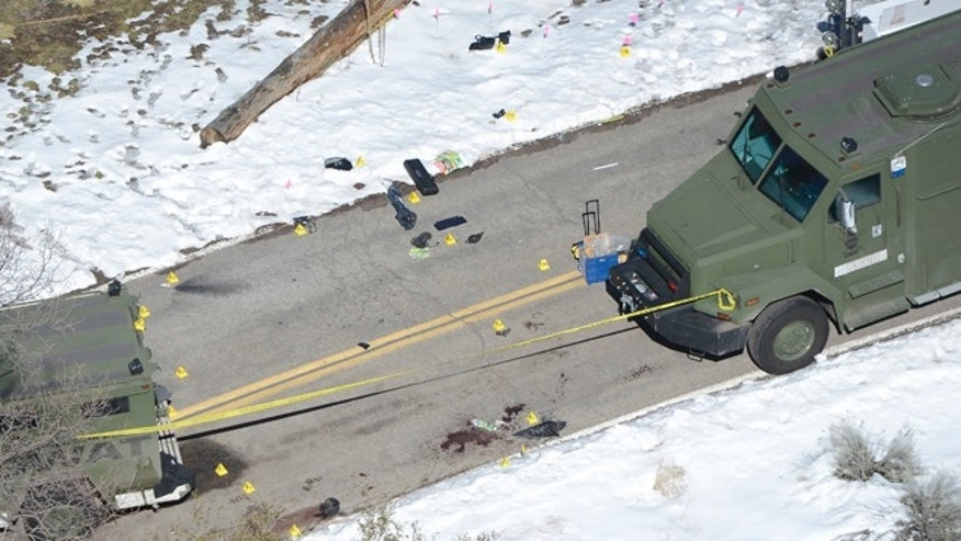 Feb. 13, 2013: Markers and blood stains are seen on a street near a burnt out cabin near Angelus Oaks, California where police believe they engaged in a shootout with fugitive former Los Angeles police officer Christopher Dorner on Tuesday.