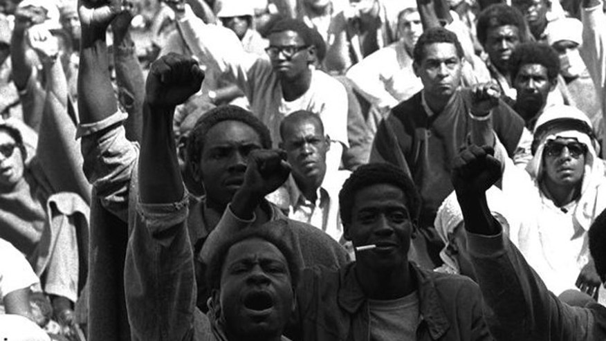 FILE 1971: Prisoners at Attica Correctional Facility raise clenched fists during riots.