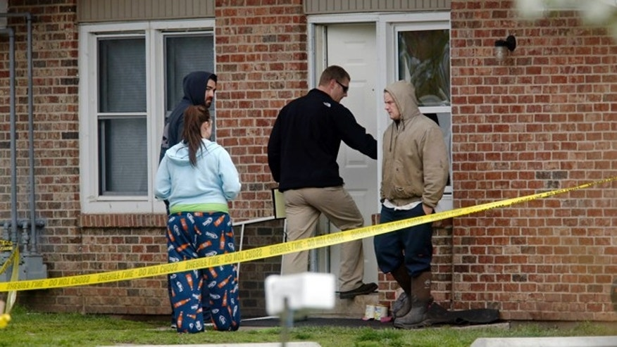 April 24: Police investigate the scene at a house in Manchester where five people were found killed. The suspect, who was not immediately identified by police, died at a hospital after a shootout with police.