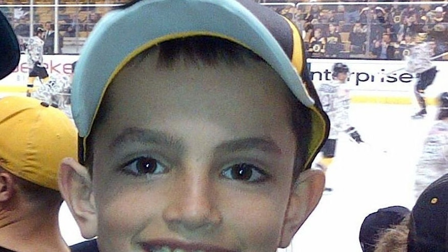 FILE - This undated photo provided by Bill Richard shows his son, Martin Richard, in Boston. Martin Richard, 8, was the youngest of three people killed in the explosions at the finish line of the Boston Marathon Monday, April 15, 2013.  A private funeral Mass, followed by burial, was held with immediate family attending Tuesday, April 23, 2013, for Martin Richard. No other details were provided.(AP Photo/Bill Richard)