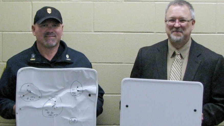 April 22, 2013: Cold Spring Record, Cold Spring Police Chief Phil Jones, left, and Rocori School District Superintendent Scott Staska pose with bulletproof white boards in Cold Spring, Minn.