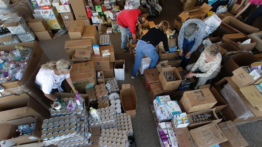 April 22, 2013: Volunteers sort through goods donated for victims of last week's fertilizer plant explosion in West, Texas.