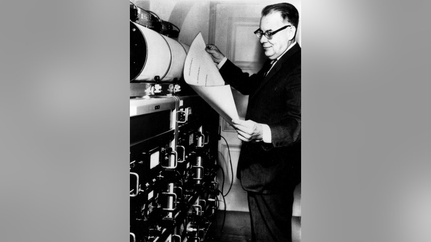 FILE - In this 1963 file photo, American seismologist Charles Francis Richter, who developed the first widely used seismic magnitude scale in 1935, studies earthquake tremors in his laboratory in Pasadena, Ca., in 1963. A ceremony in honor of Charles Richter Day, where he was born in 1900, is planned this Friday in Butler County, about 25 miles north of Cincinnati. (AP Photo, File)