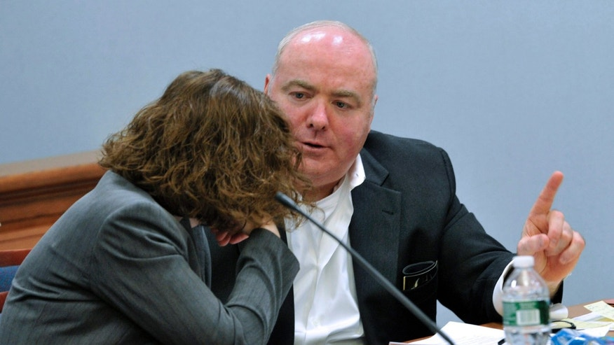 Michael Skakel, right, talks with one of his defense attorneys, Jessica Santos, at Skakel's habeas corpus trial at State Superior Court in Vernon, Conn., on Wednesday, April 24, 2013.   Skakel, who did not testify at his trial but did speak at last year when he was denied parole, began testifying Wednesday. (AP Photo/The Stamford Advocate,Jason Rearick, Pool )
