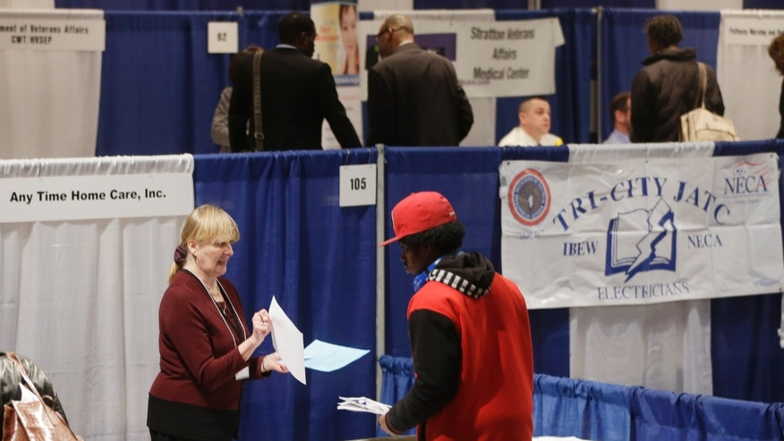 In this Thursday, April 11, 2013, photo, Kathie Maiello of Any-Time Home Care, left, talks with Jashod Chaney of Albany at the Dr. King Career Fair at the Empire State Plaza Convention Center, in Albany, N.Y.  The Labor Department reports on the number of Americans who applied for unemployment benefits last week on Thursday, April 25, 2013. (AP Photo/Mike Groll)