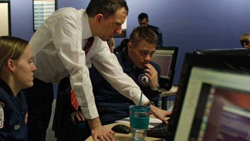 Feb. 20, 2013: Martin Carlisle, standing, a computer science professor at the Air Force Academy and director of the school's Center for Cyberspace Research, instructs cadets in cyber warfare, at the U.S. Air Force Academy, in Colorado Springs, Colo.