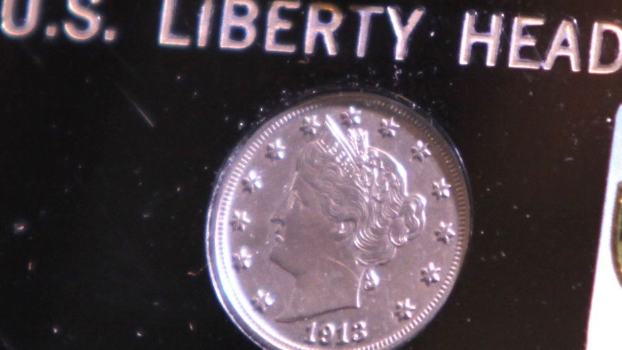 This 1913 Liberty Head Nickel - one of only five known to exist - was auctioned Thursday, April 25, 2013  night during the Central States Numismatic Society show at the Schaumburg Convention Center in Schaumburg, Ill. for $3,172,500 (AP Photo/Daily Herald, Patrick Kunzer)