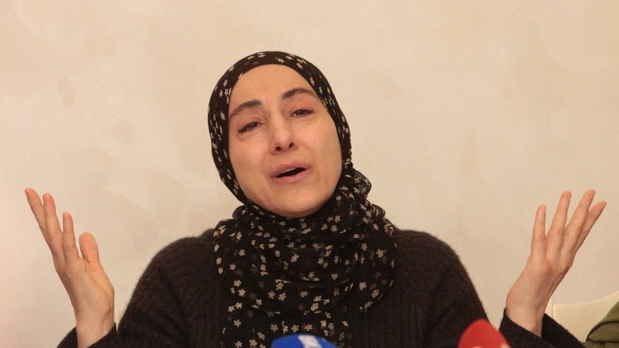 The mother of the two Boston bombing suspects, Zubeidat Tsarnaeva, speaks at a news conference in Makhachkala, the southern Russian province of Dagestan, Thursday, April 25, 2013. The father of the two Boston bombing suspects said Thursday that he is leaving Russia for the United States in the next day or two, but their mother said she was still thinking it over. (AP Photo/Musa Sadulayev)