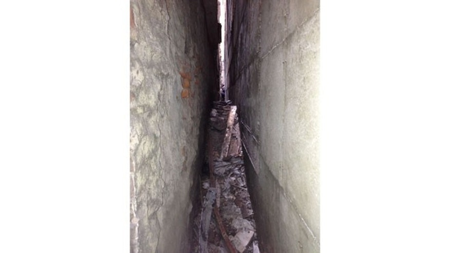 The chunk of landing gear was found in this narrow alley between buildings on Park Place and Murray Street.