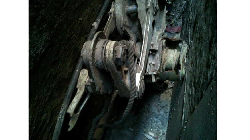 Surveyors hired by the owner of 51 Park Place in lower Manhattan discovered in a small alley behind the building this piece of landing gear from one of the two commercial planes that were flown into the World Trade Center by terrorists on Sept. 11, 2001.