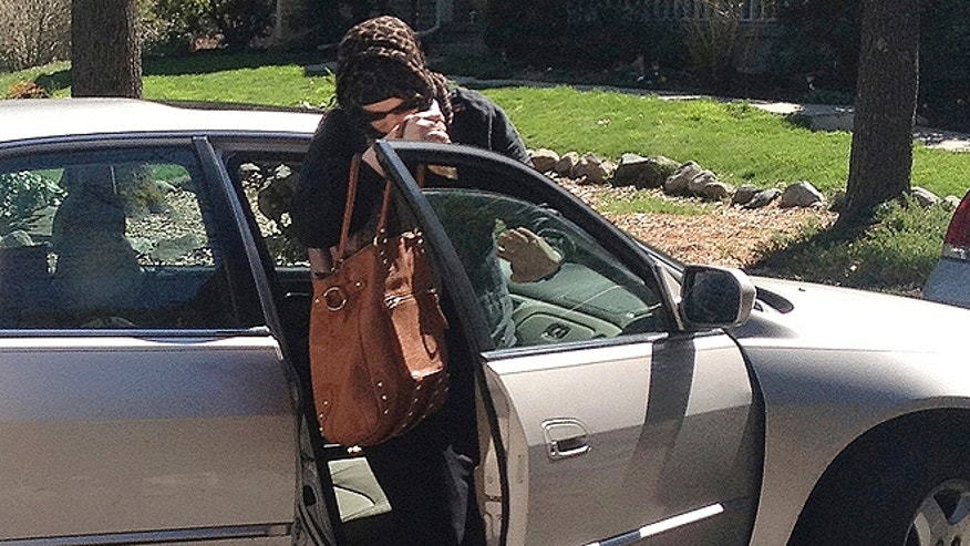 April 21, 2013: Katherine Russell Tsarnaev, wife of killed Boston Marathon bombing suspect Tamerlan Tsarnaev, exits a car at the home of her parents in North Kingstown, R.I. At left is her father, Warren Russell. (AP)