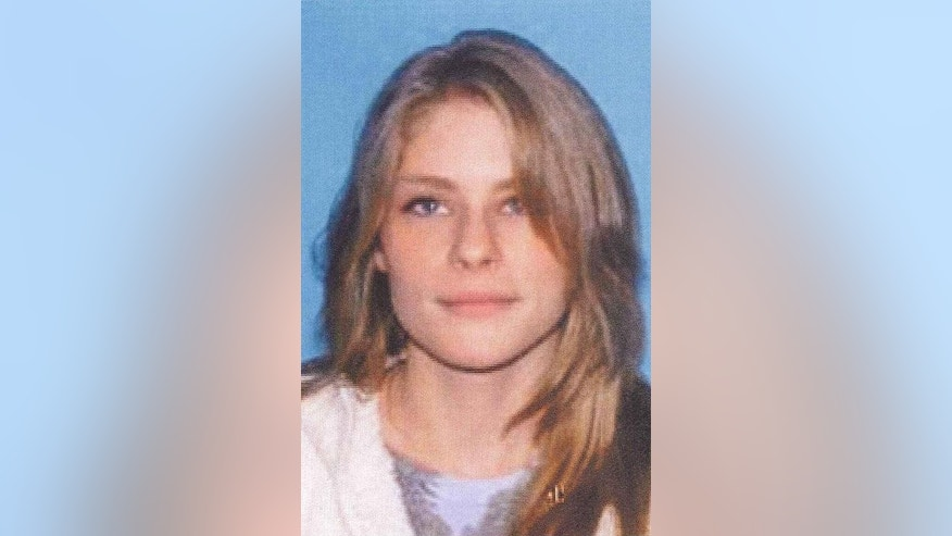 This undated photo released by police in Norton Shores, Mich., shows Jessica Heeringa, 25, who apparently was abducted Friday, April 26, 2013, from the Exxon Mobil gas station where she worked as a clerk in Norton Shores. Police on Sunday, April, 28, 2013, said they were seeking information on a silver minivan and its male driver seen in the area about the time of her disappearance. (AP Photo/Norton Shores Police Department)