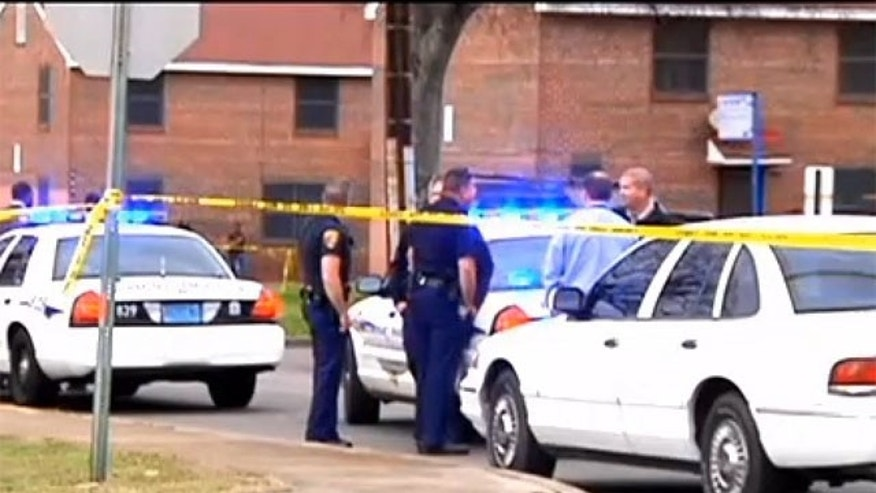 April 29, 2013: Police respond to the scene after a Birmingham woman was shot dead while holding her infant.
