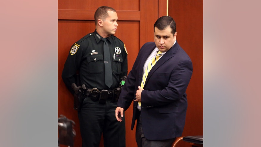 "George Zimmerman, defendant in the killing of Trayvon Martin, walks by an officer in Seminole circuit court, in Sanford, Fla., during a pre-trial hearing, Tuesday, April 30, 2013.   Zimmerman says he agrees with his attorneys' decision not to seek an immunity hearing under the state's ""Stand Your Ground"" self-defense law. (AP Photo/Orlando Sentinel, Joe Burbank, Pool)"