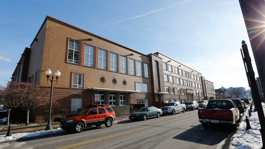 FILE-- This file photo from Jan. 9, 2013,  shows the Steubenville High School in Steubenville, Ohio. Ohio Attorney General Mike DeWine said on Thursday April 25, 2013 that search warrants have been executed at the high school attended by the two football players convicted in this trial. DeWine's office says in a statement that search warrants were also executed Thursday at the Steubenville school board offices and a northeast Ohio digital investigations company. (AP Photo/Keith Srakocic, File)