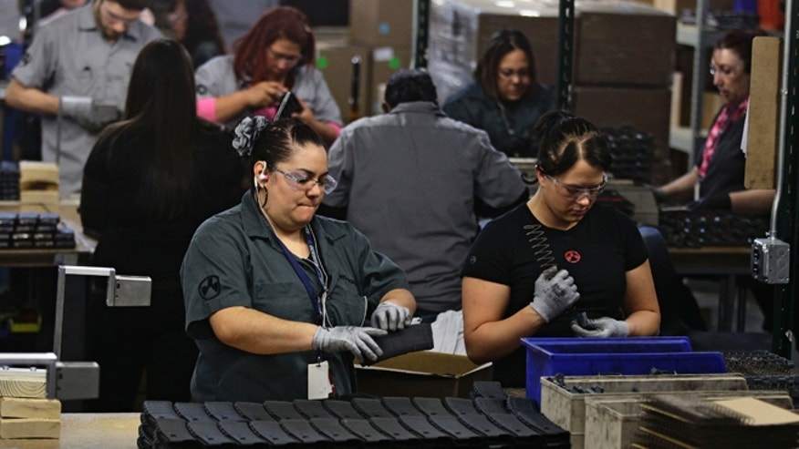 Feb. 28, 2013: In this photo, workers assemble 30-round capacity ammunition magazines for high-velocity rifles, inside the Magpul Industries plant in Erie, Colo.