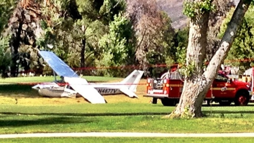 April 29, 2013: A plane is examined by investigators after making an emergency landing on a Los Angeles-area golf course.