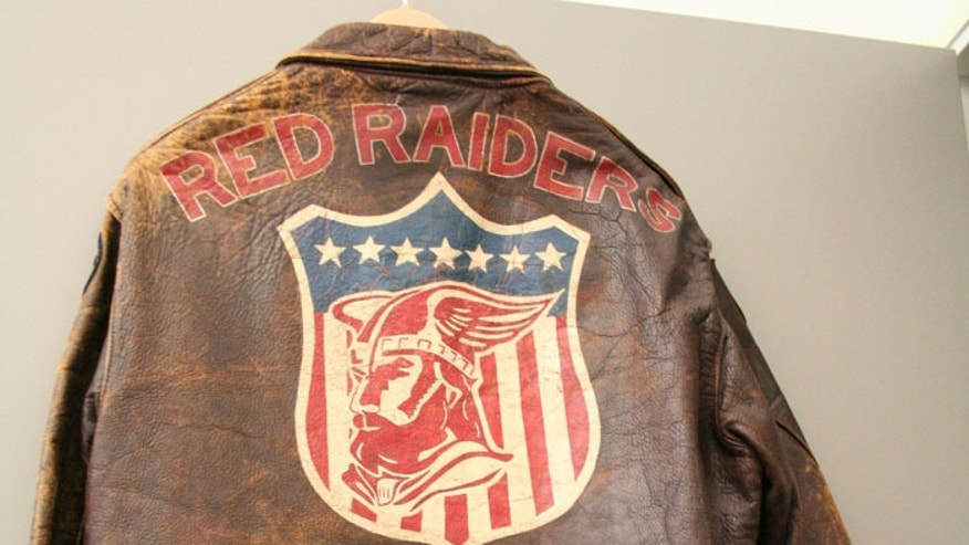 "WWII leather bomber jacket found in Washington, D.C. thrift shop had a red-bearded man in a winged helmet, the words ""Red Raiders"" and ""22nd Bomb Group"" emblazoned above and below. The jacket had lieutenant bars, a pricetag of $17 and a pretty big clue as to its original owner. (Copyright: Jennifer Hlad/Stars and Stripes)"