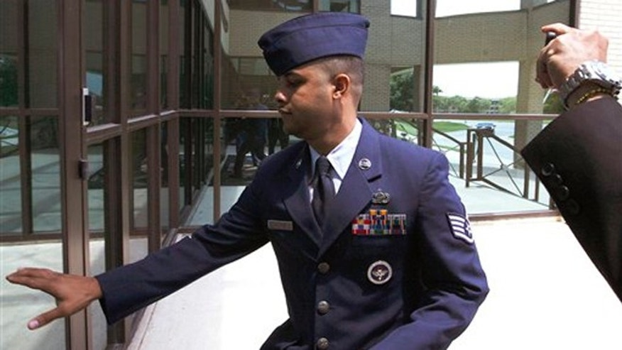 July 16, 2012: U.S. Air Force Staff Sgt. Luis A. Walker arrives from a lunch break during his court martial at Lackland Air Force Base in San Antonio.