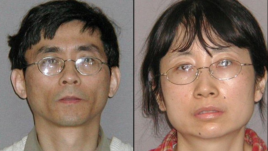 FILE - This combination of July 22, 2010 file photos provided by the U.S. Marshals Service shows Yu Qin, left, and his wife, Shanshan Du. The former General Motors engineer and her husband face up to 10 years in prison for stealing hybrid trade secrets from the big automaker. Sentencing is scheduled Tuesday, April 30, 2013 in federal court. (AP Photo/U.S. Marshals Service, File)