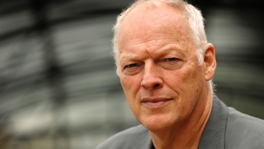FILE -  An Aug. 13, 2008, file photo is of former Pink Floyd band member David Gilmour in London. Police say a 53-year-old man who went to a Minnesota hospital for treatment on April 20, 2013, is accused of pretending to be singer-guitarist David Gilmour _ and racking up as much as $100,000 in unpaid medical bills. Authorities say the man didn't have health insurance, was treated and released, but not before signing an autograph. (AP Photo/Joel Ryan, File)