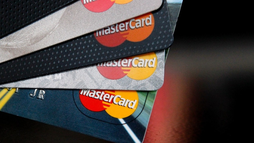 In this Thursday, April 25, 2013, photo, MasterCard credit cards are displayed for a photographer in Montpelier, Vt. MasterCard Inc. reports quarterly financial results before the market opens on Wednesday, May 1, 2013. (AP Photo/Toby Talbot)