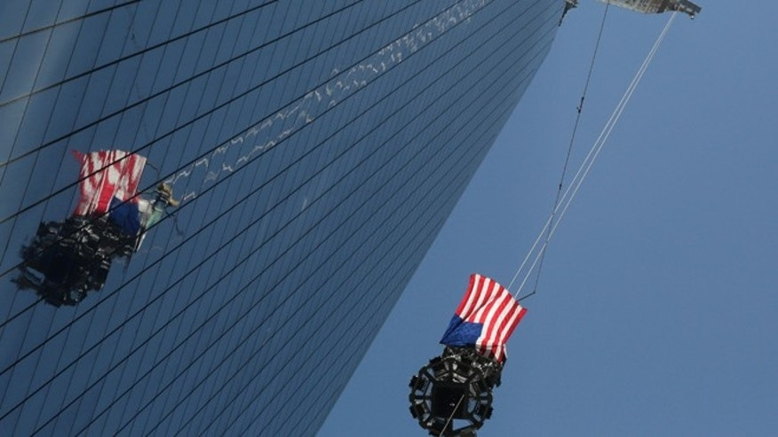 May 2: The final piece of spire is hoisted to the roof of One World Trade Center, in New York.