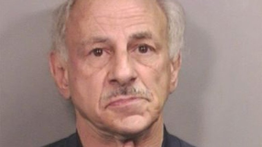 William Hotz, 59, is accused of punching a 55-year-old ice cream shop worker in the face after police say she refused to accept an expired coupon.