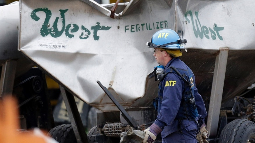 An investigators carries a piece of debris amid the destroyed fertilizer plant in West, Texas, Thursday, May 2, 2013. Investigators face a slew of challenges in figuring out what caused the explosion at the fertilizer plant that killed 14 people and destroyed part of the small Texas town. (AP Photo/Pool/ LM Otero)