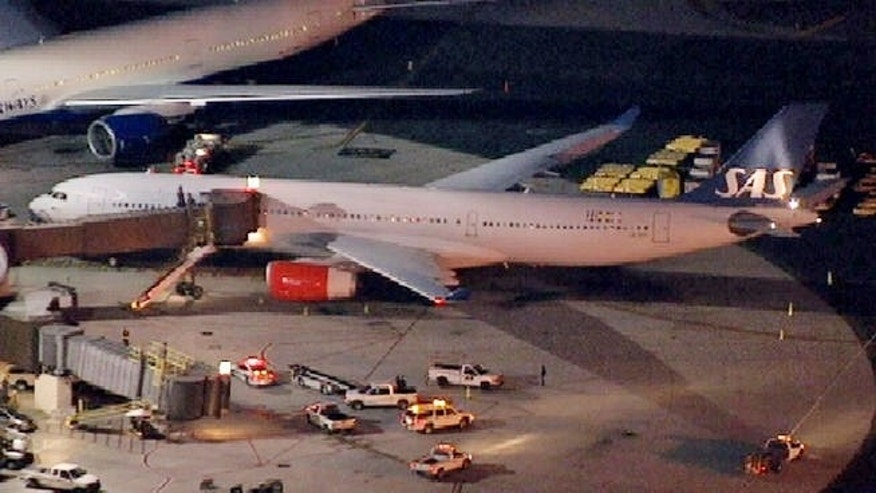 May 1, 2013: A damaged SAS Airbus A330 sits on the tarmac at New Liberty International Airport after clipping the wing of another aircraft on takeoff.