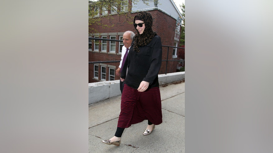 April 29, 2013: Katherine Russell, right, wife of Boston Marathon bomber suspect Tamerlan Tsarnaev, leaves the law office of DeLuca and Weizenbaum with Amato DeLuca, left in Providence, R.I.